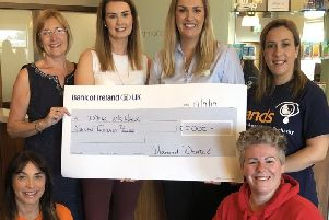 Staff at Diamond Dental Clinic raised 7,000 for five charities 'close to their hearts'. Members of staff are pictured with representatives of the charities.