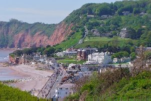 The view overlooking the town of Sidmouth from Salcombe Hill with the magnificent Belmont and Victoria hotels in the centre of the picture looking out across Lyme Bay.