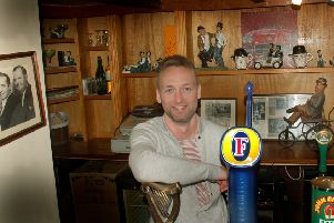Landlord Callum McIver with some of the Laurel and Hardy memorabilia at The Bull Inn, at Bottesford EMN-190116-091613001