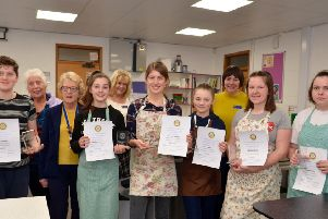 Susan Waring, President of the  Rotary Club of Sleaford, with local winnners and fellow competitors at the High School cook-off. EMN-190122-135901001