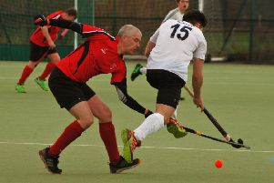 Pete Frederick makes a challenge for Melton Seconds in their 8-0 home defeat to Market Harborough First XI EMN-190129-112546002