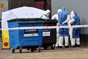 Police and forensic officers pictured at the scene where a body of a man was found in the Keylands Place area on Friday afternoon.'Mandatory Credit Presseye /Stephen Hamilton