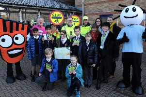 Bourton Meadow Academy in Buckingham launches its upcoming Walk to School Week campaign.'Pictured are pupils, staff, Living Streets and Bucks County Council representatives.