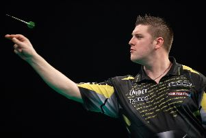 Daryl Gurney in action against James Wade. Steve Welsh/PDC