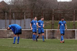 The Desborough Town players look dejected after conceding a goal in the 2-0 home defeat to Daventry Town in the UCL Premier Division. Pictures by Alison Bagley