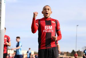 Rhys Hoenes celebrates after scoring Kettering Town's opening goal from the penalty spot in their 2-0 win over St Neots Town at Latimer Park. Picture by Peter Short