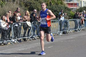 Rhys Boorman approaches the finish line in yesterday's Hastings Half Marathon. Picture by Justin Lycett