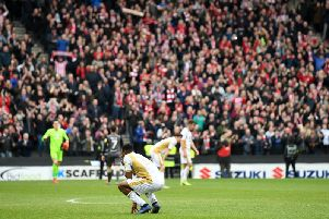Dons show their disappointment while the Lincoln fans celebrate