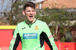 Banbury United keeper Jack Harding urges his side on against King's Lynn Town. Photo: Steve Prouse