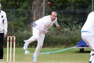 Middleton Cheney bowler Steve Wilkes sends down a delivery against Oxenford