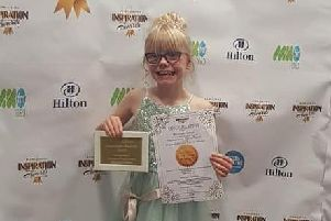 Amazing Miyla with her award