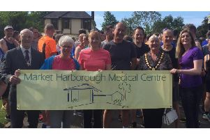Staff from the Market Harborough Medical Centre, along with Chairman of Harborough District Council Cllr Barbara Johnson, at the Park Run in Welland Park on Saturday.