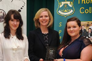 Mrs. Tessa Breslin presenting Charlotte Kenton and Lauren O'Doherty with prize-giving awards at Thornhill College during a visit to her alma mater in 2014.