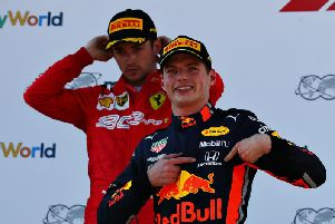 Verstappen celebrates in front of Leclerc on the podium