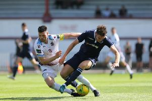 Jack Dixon challenging for the ball against Millwall.