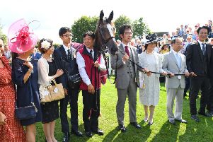 Connections of the Japanese horse Deirdre celebrate her Nassau Stakes win / Picture by Malcolm Wells
