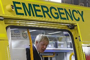 Prime Minister Boris Johnson inspects an ambulance during a visit to Pilgrim Hospital in Boston, Lincolnshire, to announce the government's NHS spending pledge of 1.8 billion. PRESS ASSOCIATION Photo. Picture date: Monday August 5, 2019. See PA story POLITICS Brexit. Photo credit should read: Darren Staples/PA Wire EMN-190608-112613001