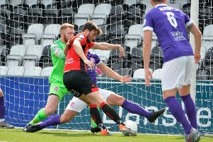 Philip Lowry breaks the deadlock at Seaview with a close-range hooked finish against Larne.