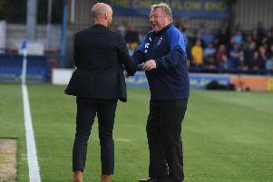 Paul Tisdale and Wally Downes shake hands before the Carabao Cup game
