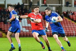 Steelstown's Ryan Devine and Claudy's Shane McGahon battle during the first meeting between the sides on Friday night before the Mitchels eventually won through in the replay.