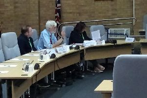 Cllr Norman Miles (centre) speaking in the council chamber