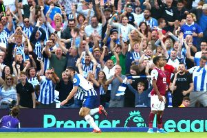 BRIGHTON, ENGLAND - SEPTEMBER 14: Neal Maupay of Brighton and Hove Albion celebrates after scoring his team's first goal during the Premier League match between Brighton & Hove Albion and Burnley FC at American Express Community Stadium on September 14, 2019 in Brighton, United Kingdom. (Photo by Dan Istitene/Getty Images) SUS-190914-181725002