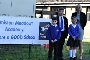 Kelly Moore with pupils at the school