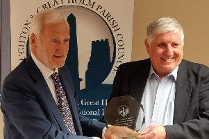 Andy Dransfield, right, received an honour from Loughton & Great Holm Parish Council on Monday but on Wednesday the borough council snubbed him