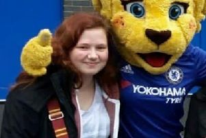 Chelsea fan Leah with the club's mascot