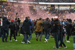 Fans invaded the pitch following Dons' promotion to League One