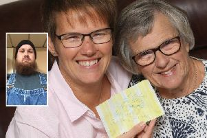 Melanie Harris and her mother Eileen Webb with the note from the bottle. Inset: Nicholas Smithling