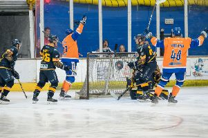 Martins Susters (left) celebrates opening the scoring for Phantoms against Raiders. Photo: Tom Scott