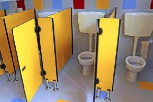 Unisex toilets are popular with students, says the head teacher