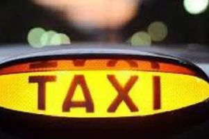 A hackney carriage sign