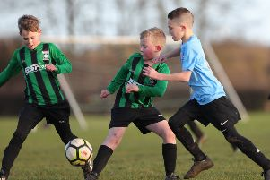 Asfordby and Melton showed great spirit and respect in their under 9s derby match. Picture courtesy of Phil James EMN-191012-165438002