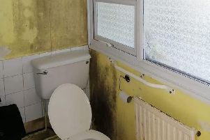 The bathroom is covered in black mould