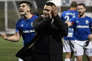 Linfield boss David Healy and his players celebrate beating Cliftonville on Monday night. Pic by Pacemaker.