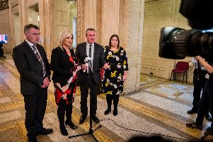 Finance Minister Conor Murphy (second from right) of Sinn Fein with Deputy First Minister Michelle O'Neill (second from left) and party colleagues Junior Minister Declan Kearney and Communities Minister Deirdre Hargey at the Great Hall in Stormont Buildings. (Photo: Liam McBurney/PA Wire)
