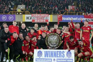 Cliftonville players celebrate their dramatic win over Ballymena United