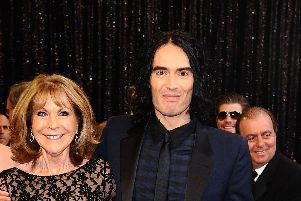 """File photo dated 27/02/11 of Russell Brand and his mother Barbara, who was rushed to hospital after being badly injured in a hit-and-run car crash. The comedian has cancelled the rest of his tour following his mother's accident - saying she had sustained """"numerous, life-threatening injuries""""."""