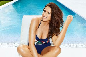 Lisa Snowdon wearing Simply Yours Panelled Bandeau Swimsuit, �35, available from JD Williams. PA