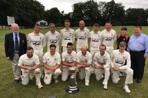 The victorious Templepatrick CC First XI team with scorer Finn Lutton, NCU president Clarence Hiles and Tony Nicholl from Junior Cup sponsors GMcG Chartered Accountants. PICTURE: Duncan Elder