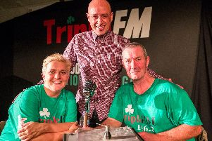 """Actors Jo Donnelly (left) and Martin Maguire (right) with writer and director Tony Devlin (centre) after a performance at the Roddy McCorley social club of Tony Devlin's play, """"A Station Once Again"""", remembering the west Belfast radio station, """"Triple FM"""", during 30th year of Feile an Phobail (The Community's Festival) in Belfast"""