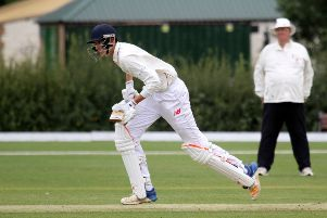 Banbury batsman Ollie Clarke runs them up on his way to 75 against Oxford at White Post Road
