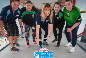 NWRC Lecturer Michelle Gormley McLaughlin (centre) gets some encouragement from Joe Gallanagh, Sports Lecturer and City of Derry Rugby team mates: Sarah McKittrick, Charlene Rodgers and Nicola Duddy.