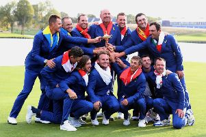 Team Europe celebrates after regaining the Ryder Cup on Sunday