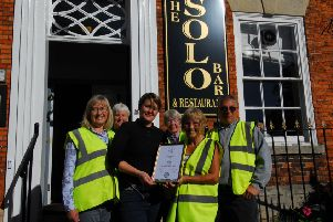 Sleaford In Bloom members present Sophie Hatcher of the Solo Bar with the East Midlands in Bloom silver award for best hotel and pub garden display. EMN-180928-093745001