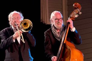 The late Jackie Flavelle (right) on stage with Chris Barber.