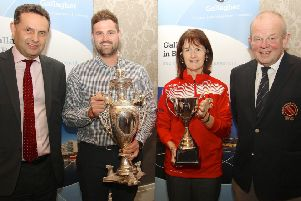 The holders of the Northern Cricket Union's Gallagher Challenge Cups''at last night's draws for next season's men and women's early rounds:''James Hall of Waringstown and Sandra Grieve of Lurgan.''The draws were made by Shane Matthews, NI regional managing director''of Gallagher, and the President of the NCU, Richard Johnson.