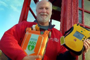 Martin Fagan, national secretary of the Community Heartbeat Trust, shows off one of the defibrillators the organisation installs around the borough EMN-190122-171813001